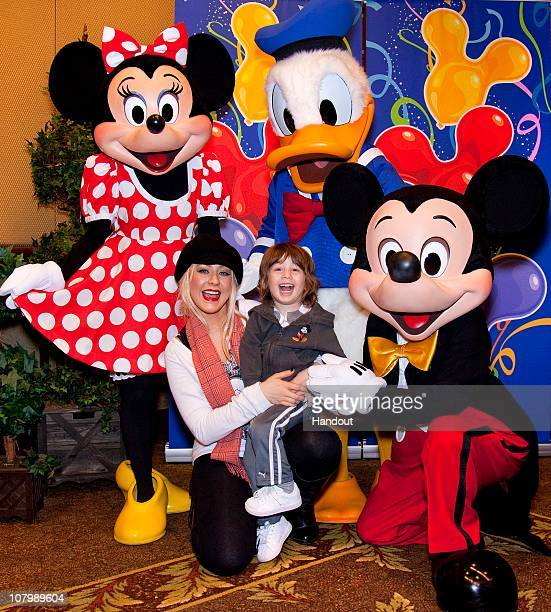 In this handout photo provided by Disney Christina Aguilera and son Max celebrate his 3rd birthday with Mickey Mouse Minnie Mouse and Donald Duck at...