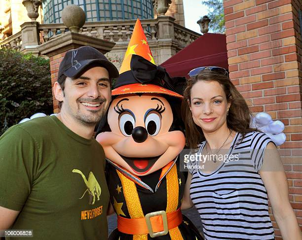 In this handout photo provided by Disney country music artist Brad Paisley and his wife actress Kimberly WilliamsPaisley pose with a Halloweenclad...