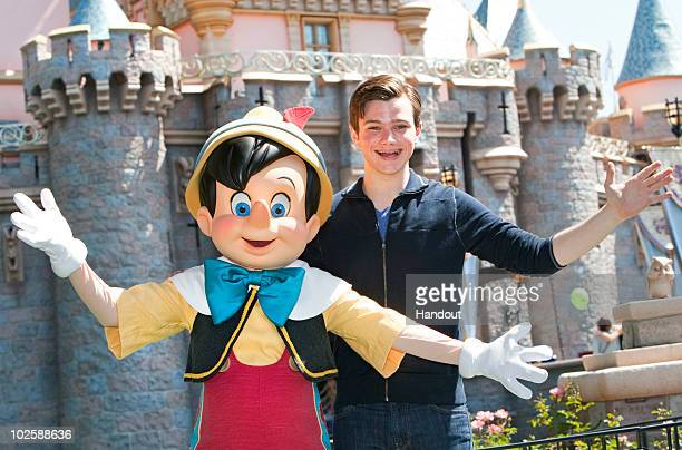 In this handout photo provided by Disney Glee star Chris Colfer meets his favorite Disney character Pinocchio at Disneyland on July 2 2010 in Anaheim...