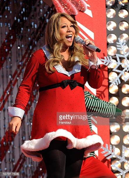 In this handout photo provided by Disney Grammy Awardwinning singer Mariah Carey performs while taping the Disney Parks Christmas Day Parade TV...