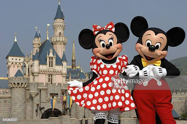 In this handout photo provided by Disney, Mickey and Minnie Mouse are seen in front of the Sleeping Beauty Castle at the new Disneyland Park on...
