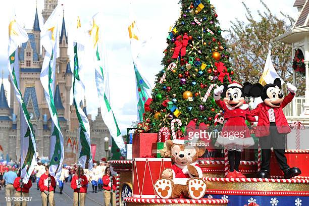 In this handout photo provided by Disney Mickey and Minnie Mouse wave to the crowd while taping the Disney Parks Christmas Day Parade TV special in...