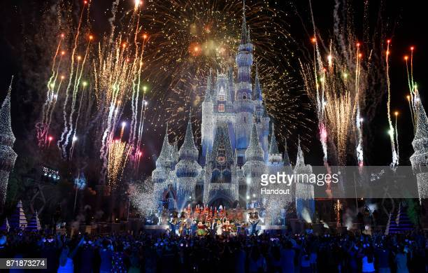 In this handout photo provided by Disney Parks, a view of fireworks, holiday lights and fanfare at Cinderella's Castle during a taping of Disney...