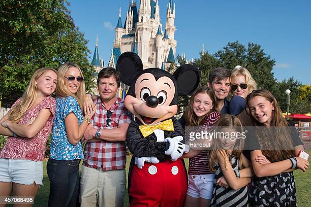 "In this handout photo provided by Disney Parks, acting legend Michael J. Fox and ABC News' chief anchor/""Good Morning America"" anchor George..."
