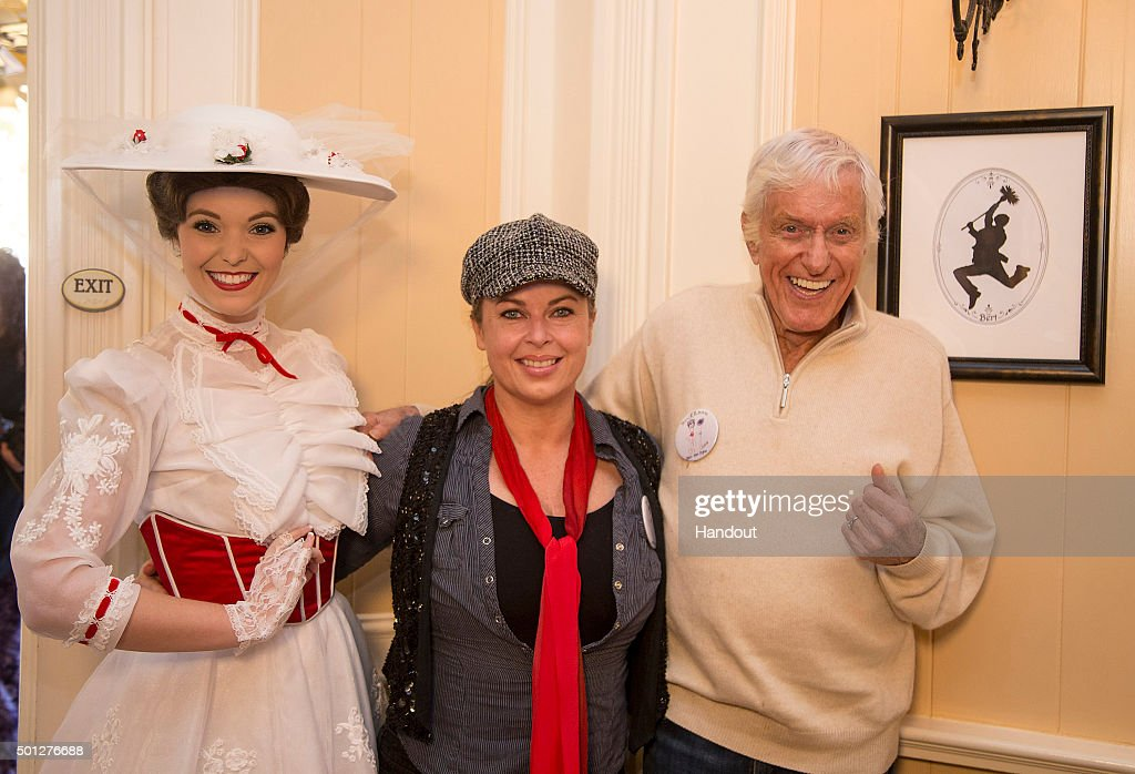 In this handout photo provided by Disney Parks, actor and Disney legend Dick Van Dyke (R), wife Arlene Silver Van Dyke (C) and Mary Poppins celebrate his 90th birthday at Disneyland on December 13, 2015 in Anaheim, California.