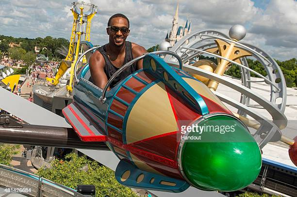 In this handout photo provided by Disney Parks actor Anthony Mackie Falcon in 'AntMan' takes flight July 20 2015 on Astro Orbiter at Magic Kingdom...