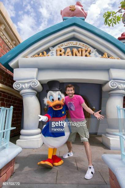 In this handout photo provided by Disney Parks actor David Tennant poses with Scrooge McDuck who made a special appearance in Mickeys Toontown July...