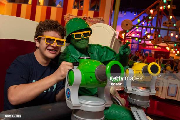 In this handout photo provided by Disney Parks, actor Gaten Matarazzo visits Toy Story Land at Walt Disney World Resort on Friday, April 26, 2019 in...