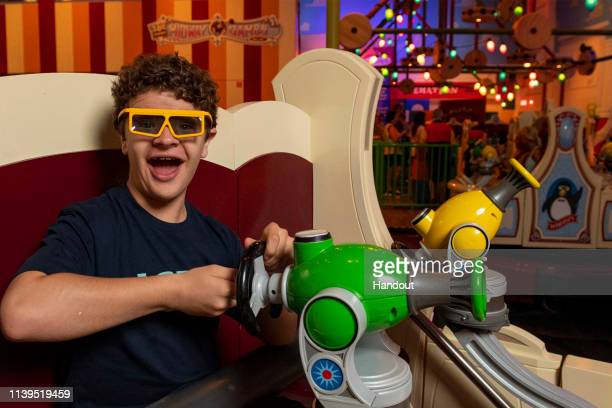 In this handout photo provided by Disney Parks actor Gaten Matarazzo visits Toy Story Land at Walt Disney World Resort on Friday April 26 2019 in...