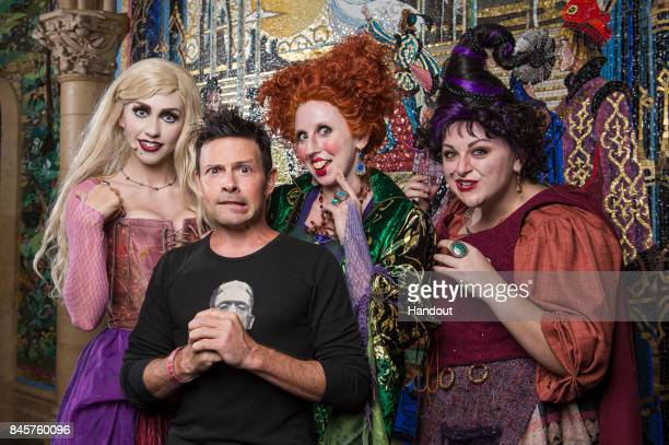 In this handout photo provided by Disney Parks Actor Jason Marsden who voiced the cat Thackery Binx in Disney's Hocus Pocus visits the infamous...