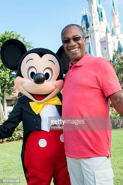 """In this handout photo provided by Disney Parks, actor Joe Morton of ABC series """"Scandal"""" poses with Mickey Mouse in the Magic Kingdom Park at the..."""