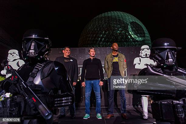 In this handout photo provided by Disney Parks actor Mads Mikkelsen makes a special appearance at Walt Disney World Resort as the iconic Spaceship...
