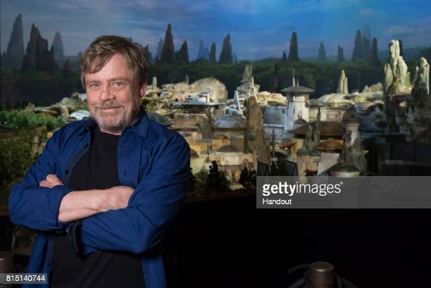 In this handout photo provided by Disney Parks actor Mark Hamill visits Galaxy's Edge the new Star Warsthemed land at Disney Parks on July 14 2017 in...