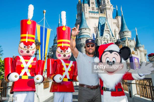 In this handout photo provided by Disney Parks actor Matthew McConaughey visit the Magic Kingdom Park on December 18 2017 at Walt Disney World Resort...