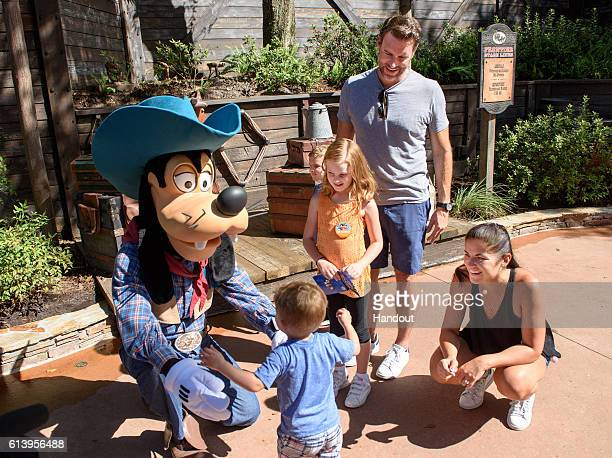 In this handout photo provided by Disney Parks Actor Scott Foley from ABC's 'Scandal' and wife Marika Dominczyk surrounded by children Malina age six...