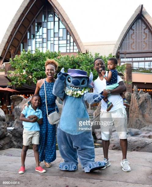 In this handout photo provided by Disney Parks Actor Sterling K Brown wife Ryan Bathe and children Andrew and Amare hang with Stitch at Aulani a...