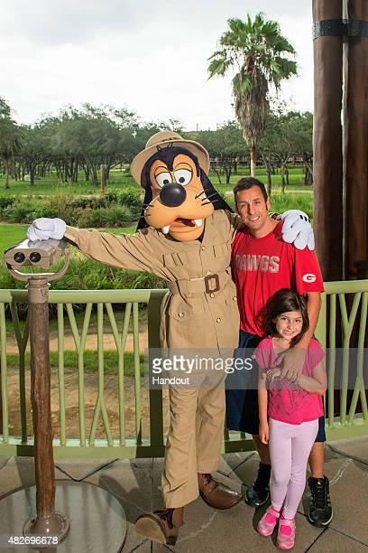 In this handout photo provided by Disney Parks actorcomedianproducer Adam Sandler and daughter Sunny Madeline share a Goofy moment on August 1 2015...