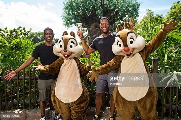 In this handout photo provided by Disney Parks actorcomedianproducer Chris Rock and Live with Kelly and Michael cohost Michael Strahan share big...