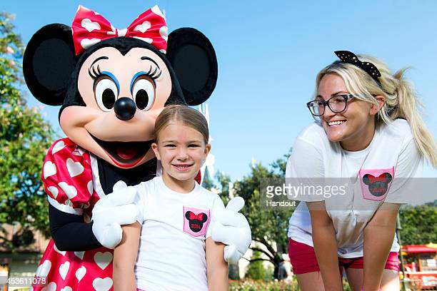 In this handout photo provided by Disney Parks actress and country music artist Jamie Lynn Spears poses with her sixyearold daughter Maddie and...