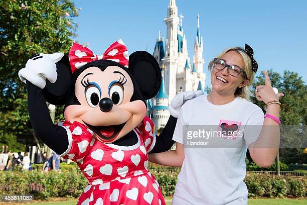 In this handout photo provided by Disney Parks actress and country music artist Jamie Lynn Spears poses Aug 14 2014 with Minnie Mouse in front of...