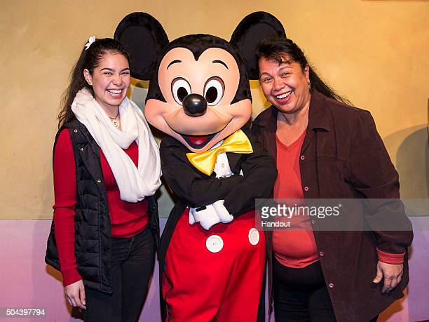 In this handout photo provided by Disney Parks actress Auli'i Cravalho who voices Moana in Walt Disney Animation Studios upcoming film Moana and her...