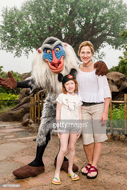 In this handout photo provided by Disney Parks actress Edie Falco and her daughter Macy pose with Rafiki at Disney's Animal Kingdom theme park March...