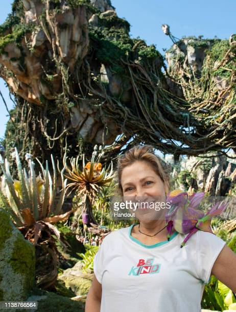 In this handout photo provided by Disney Parks actress Edie Falco poses with the new Night Blossom banshee at Pandora The World of Avatar at Walt...