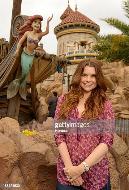 In this handout photo provided by Disney Parks actress JoAnna Garcia Swisher who portrays Ariel on the ABC series 'Once Upon A Time' poses in front...
