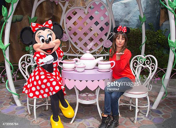 In this handout photo provided by Disney Parks, actress Lea Michele dons Minnie ears on a visit to Minnie Mouse's house in Mickey's Toontown May 14,...