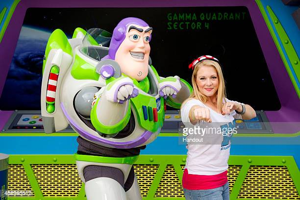 In this handout photo provided by Disney Parks, actress Melissa Joan Hart poses with Buzz Lightyear at Magic Kingdom park on September 18, 2015 in...