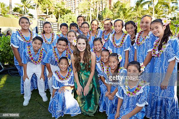 In this handout photo provided by Disney Parks 'Austin Ally' star Laura Marano poses with a children's choir at Aulani a Disney Resort Spa during...