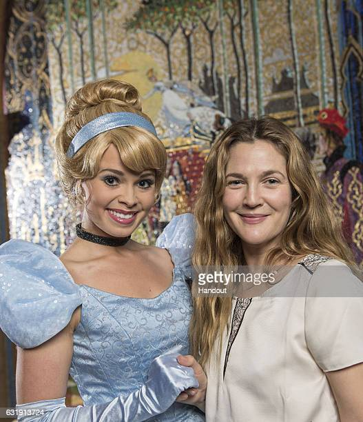 In this handout photo provided by Disney Parks awardwinning actress author director and producer Drew Barrymore meets Cinderella on Saturday January...