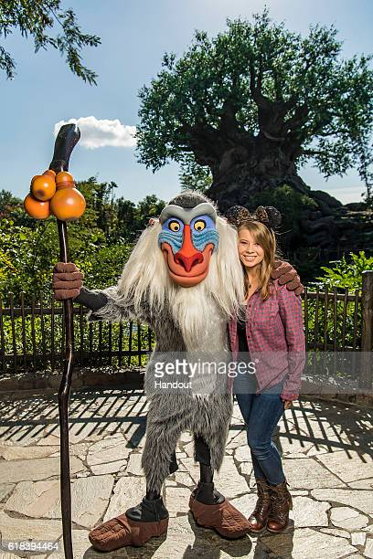 In this handout photo provided by Disney Parks awardwinning wildlife conservationist Bindi Irwin poses with Rafiki of the Lion King at Disneys Animal...