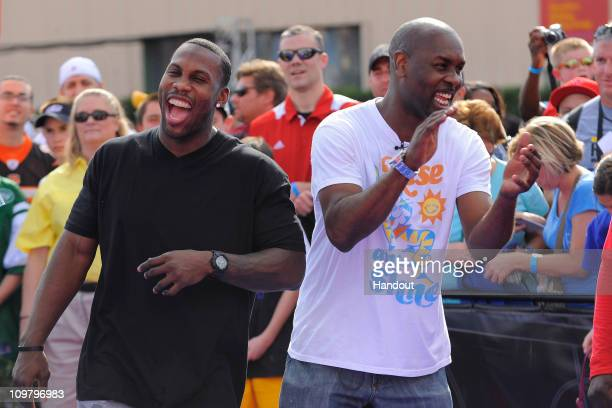 "In this handout photo provided by Disney Parks, Baltimore Ravens wide receiver Anquan Boldin and former NBA player Gary Payton attend ""ESPN The..."