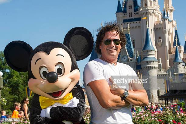 In this handout photo provided by Disney Parks Carlos Vives his wife Claudia and children Elena and Pedro visit Walt Disney World on July 9 2013 in...