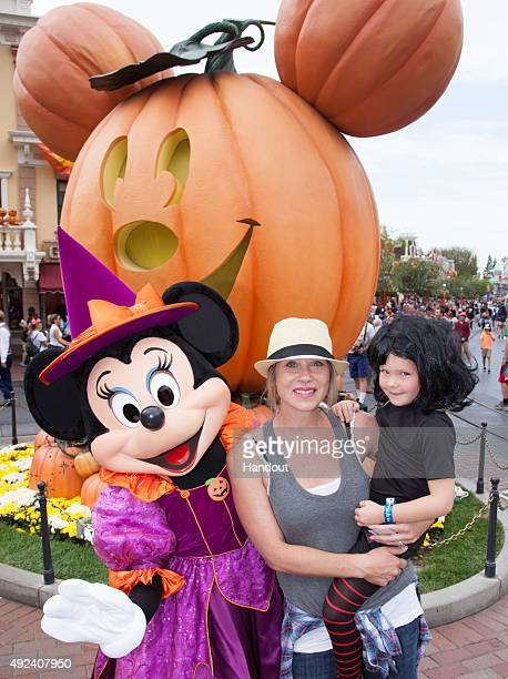 In this handout photo provided by Disney Parks Christina Applegate and daughter Sadie LeNoble celebrate Halloween Time with Minnie Mouse at...