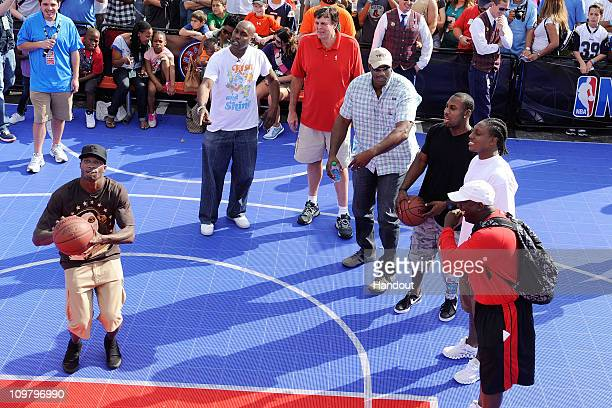In this handout photo provided by Disney Parks Cincinnati Bengals wide receiver Chad Ochocinco former NBA players Gary Payton Kevin McHale Karl...