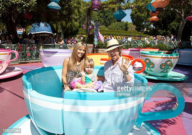 In this handout photo provided by Disney Parks, David Spade and Jillian Grace celebrate with their daughter Harper, who turned three last week, on...