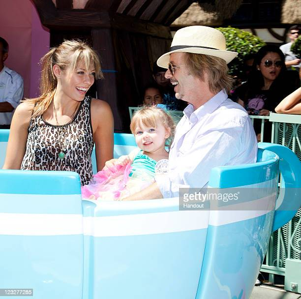 In this handout photo provided by Disney Parks David Spade and Jillian Grace celebrate with their daughter Harper who turned three last week on the...