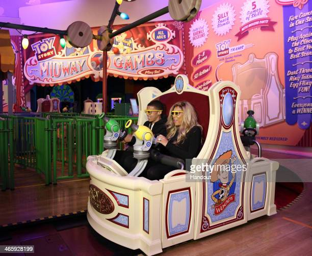 In this handout photo provided by Disney Parks daytime TV talk show host Wendy Williams and her son Kevin take a ride on 'Toy Story Midway Mania'...
