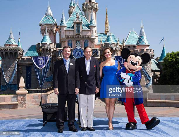In this handout photo provided by Disney parks, DAZZLING DAY - Academy Award-winning composer Richard Sherman and actress and singer Ashley Brown...