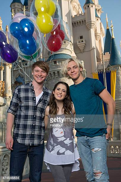 In this handout photo provided by Disney Parks Disney Channel's 'Austin and Ally' stars Calum Worthy Laura Marano and Ross Lynch pose in front of the...