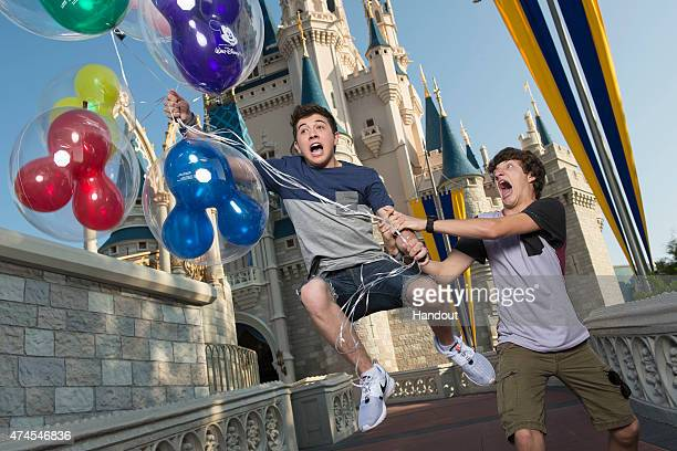 In this handout photo provided by Disney Parks Disney XD's 'Mighty Med' stars Bradley Steven Perry and Jake Short pose in front of the Cinderella...