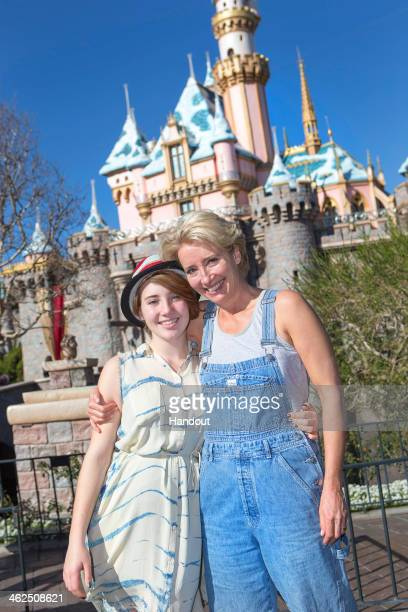 In this handout photo provided by Disney Parks Emma Thompson and her daughter Gaia Wise pose in front of Sleeping Beauty Castle at Disneyland on...