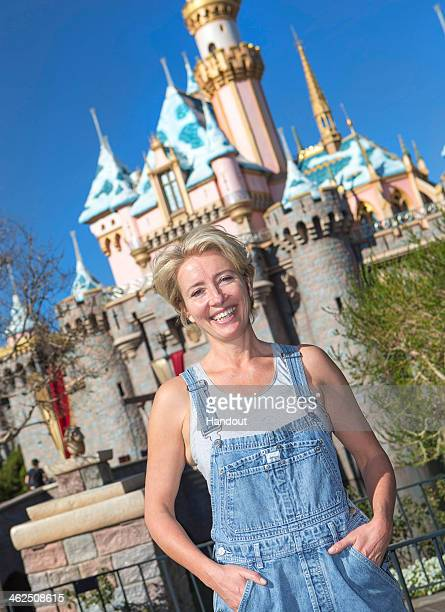 In this handout photo provided by Disney Parks Emma Thompson poses in front of Sleeping Beauty Castle at Disneyland on January 13 2014 in Anaheim...