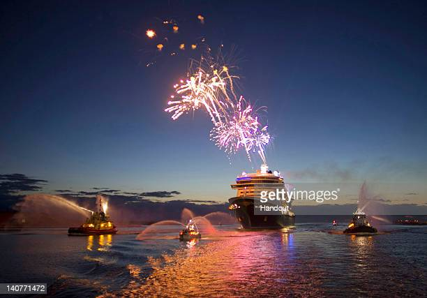 In this handout photo provided by Disney Parks fireworks light the morning sky March 6 2012 as the Disney Fantasy the newest Disney Cruise Line ship...