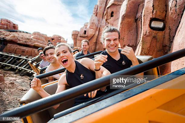 In this handout photo provided by Disney Parks Front Row LR Kimberly Perry Reid Perry Second Row Neil Perry of The Band Perry take a ride on Big...
