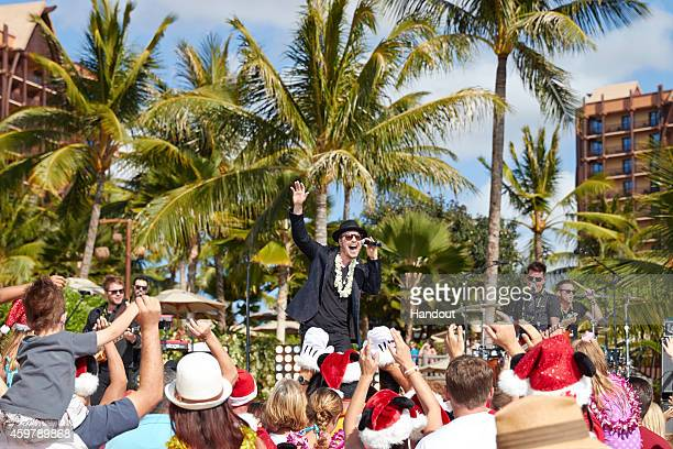 In this handout photo provided by Disney Parks Gavin DeGraw performs 'I'll Be Home For Christmas' at Aulani a Disney Resort Spa during production of...