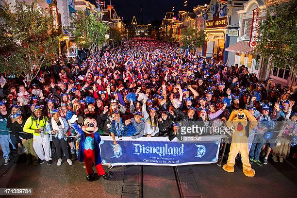 In this handout photo provided by Disney Parks GET READY TO BE DAZZLED Disneyland park guests count down to a 24hour party that kicks off the...
