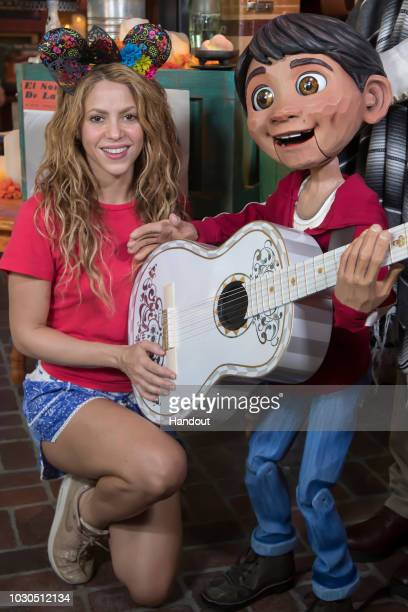 In this handout photo provided by Disney Parks Global superstar Shakira meets Miguel of DisneyPixars Coco while on break from her world tour at...